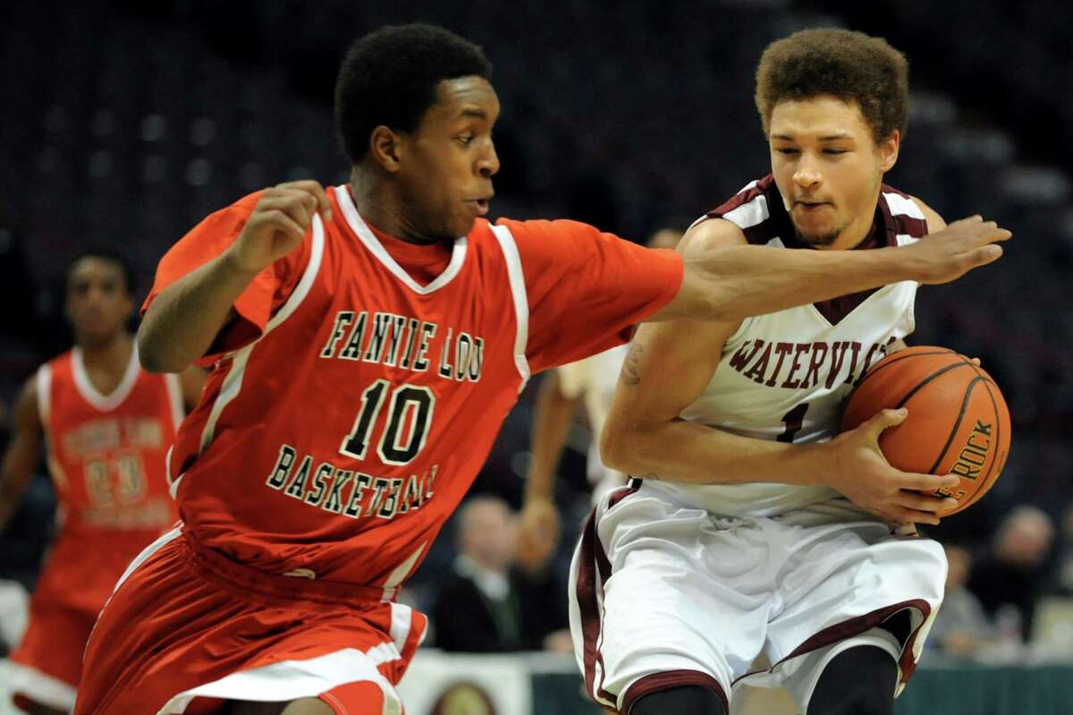 Watervliet's Jordan Gleason, right, controls the ball as Fannie Lou Hamer's Jimeek Conyers defends during their Class B State Federation basketball game on Saturday, March 23, 2013, at Times Union Center in Albany, N.Y. (Cindy Schultz / Times Union)