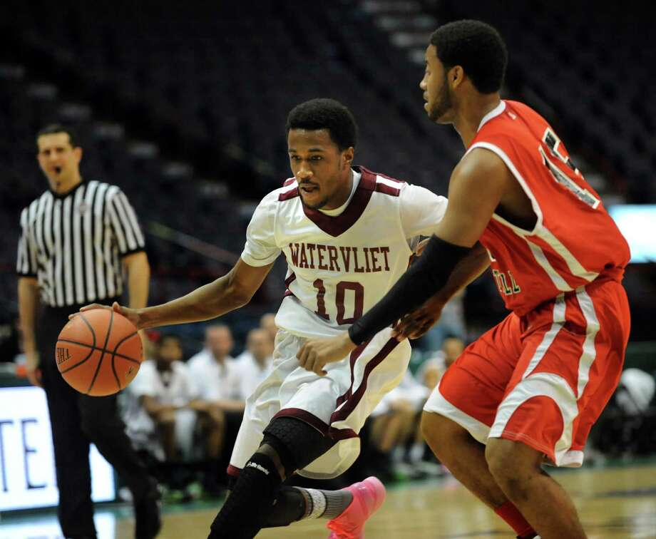 Watervliet's Tyler McLeod, left, controls the ball as Fannie Lou Hamer's Michael Castello defends during their Class B State Federation basketball game on Saturday, March 23, 2013, at Times Union Center in Albany, N.Y. (Cindy Schultz / Times Union) Photo: Cindy Schultz / 00021670A
