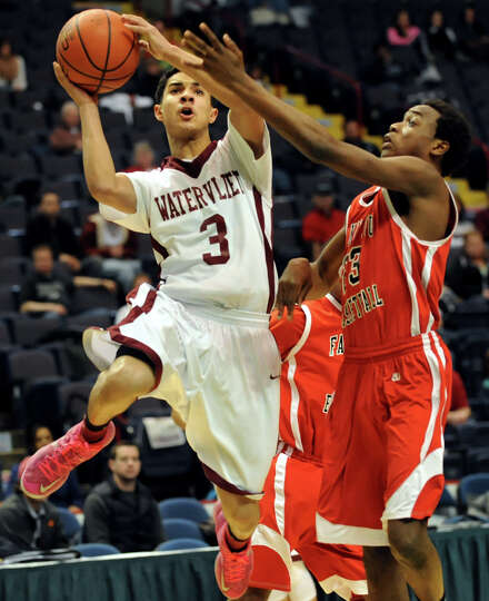 Watervliet's Ty'Jon Gilmore, left, shoots for the hoop as Fannie Lou Hamer's Isaiah Thomas defends d