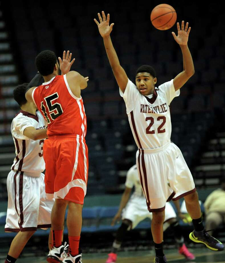 Watervliet's Henassy McConico, right, defends as Fannie Lou Hamer's Michael Castillo, center, passes the ball during their Class B State Federation basketball game on Saturday, March 23, 2013, at Times Union Center in Albany, N.Y. (Cindy Schultz / Times Union) Photo: Cindy Schultz / 00021670A