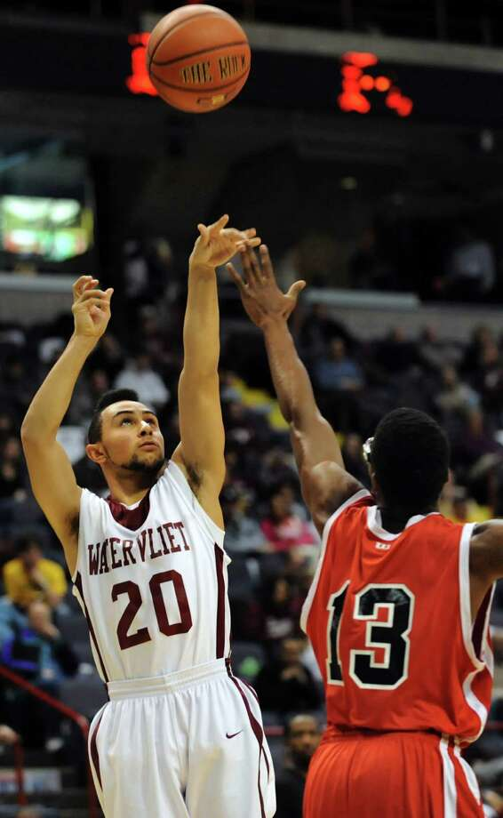 Watervliet's Jonathan Parker, left, shoots for the hoop as Fannie Lou Hamer's Oscar Norales defends during their Class B State Federation basketball game on Saturday, March 23, 2013, at Times Union Center in Albany, N.Y. (Cindy Schultz / Times Union) Photo: Cindy Schultz / 00021670A