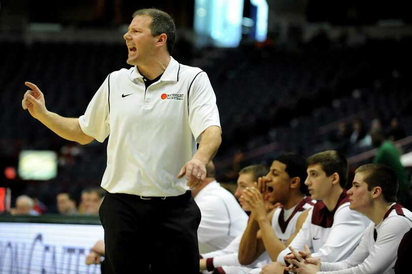 Watervliet's coach Orlando DiBacco, left, instructs his team during their Class B State Federation b