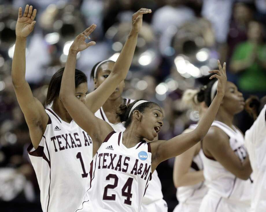 A&M's Jordan Jones (24) and her teammates rejoice after defeating Wichita State in College Station. Photo: Pat Sullivan / Associated Press