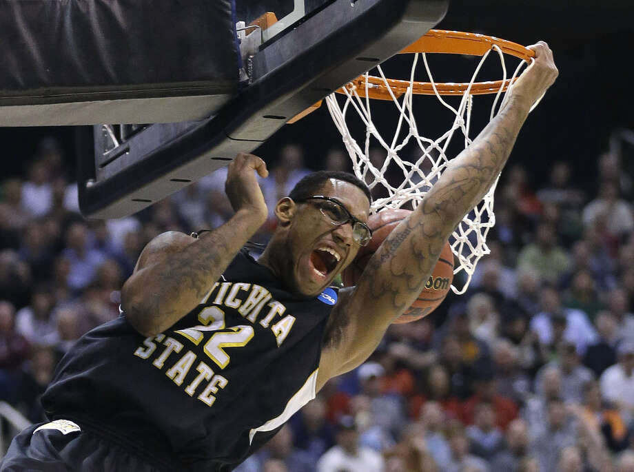 Wichita State's Carl Hall dunks the ball in the first half of the Shockers' third-round upset of Gonzaga, the West Region's No. 1 seed. Photo: Rick Bowmer / Associated Press