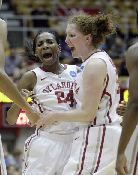Oklahoma's Sharane Campbell (left) and Joanna McFarland exult during the second half of their victory over Central Michigan. Photo: Jay LaPrete / Associated Press