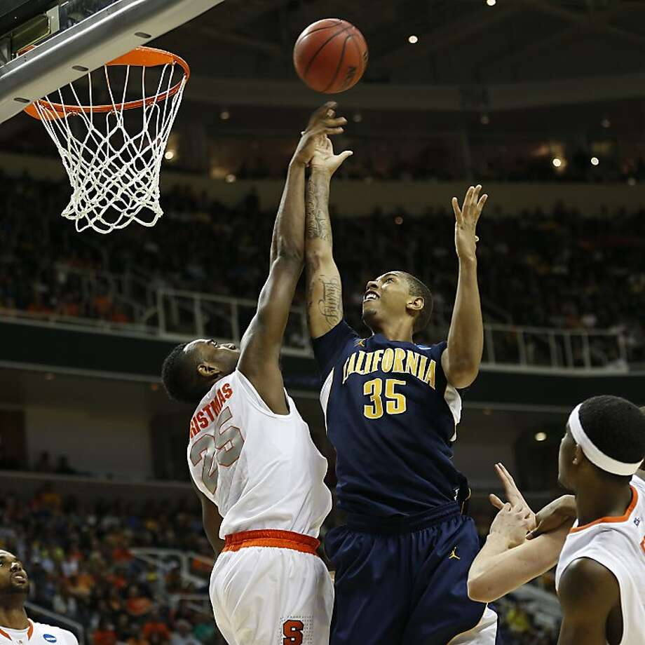 Syracuse's Rakeem Christmas blocks the shot of Richard Solomon, who had 22 points and 14 rebounds. Photo: Stephen Lam, Special To The Chronicle