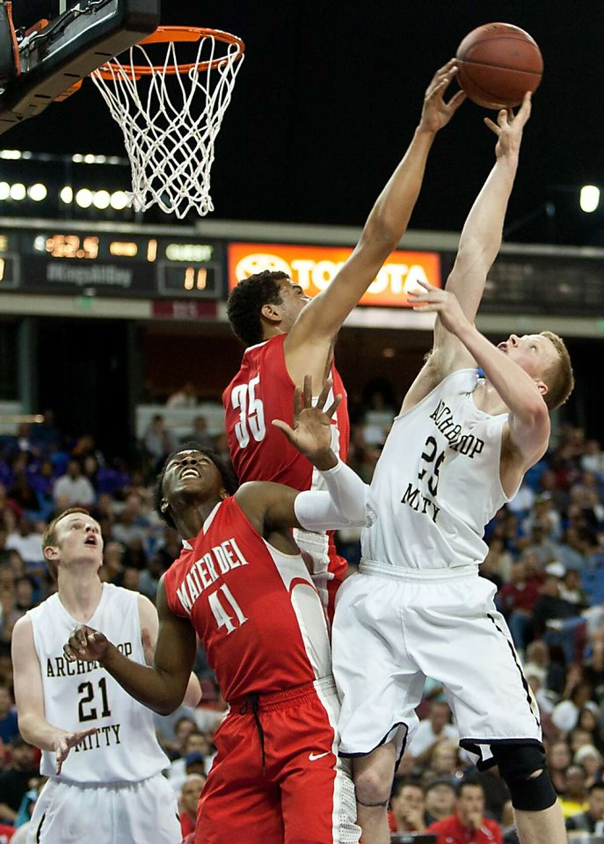 Archbishop Mitty's Brandon Farrell, right, is blocked by Mater Dei's MJ Cage, left, at the CIF State Basketball Championships March 23, 2013 in Sacramento, California.