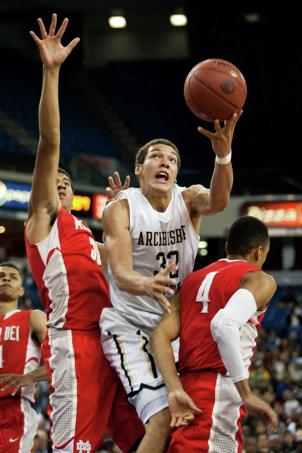 Archbishop Mitty's Aaron Gordon, center, goes to the basket against Mater Dei at the CIF State Basketball Championships March 23, 2013 in Sacramento, California.