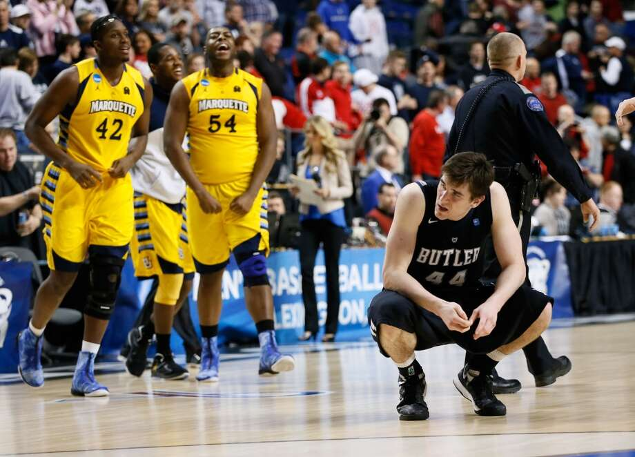 LEXINGTON, KY - MARCH 23:  Andrew Smith #44 of the Butler Bulldogs reacts as the Marquette Golden Eagles celebrate after defeating the Bulldogs during the third round of the 2013 NCAA Men's Basketball Tournament at Rupp Arena on March 23, 2013 in Lexington, Kentucky.  (Photo by Kevin C. Cox/Getty Images)