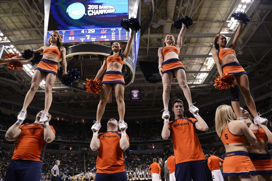 SAN JOSE, CA - MARCH 23:  The Syracuse Orange cheer team performs in the second half against the California Golden Bears during the third round of the 2013 NCAA Men's Basketball Tournament at HP Pavilion on March 23, 2013 in San Jose, California.  (Photo by Thearon W. Henderson/Getty Images)