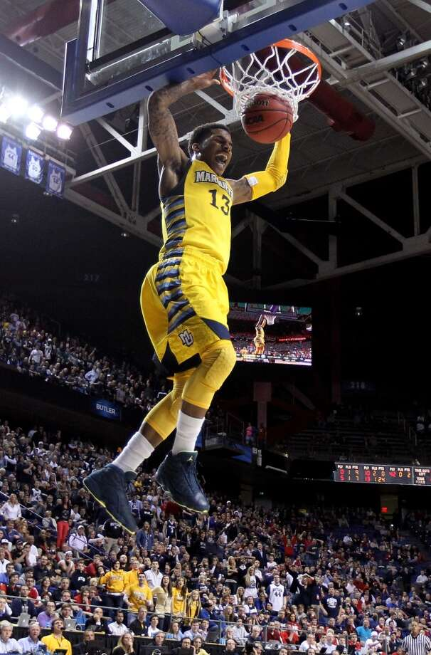 LEXINGTON, KY - MARCH 23:  Vander Blue #13 of the Marquette Golden Eagles goes up for a dunk against the Butler Bulldogs in the second half during the third round of the 2013 NCAA Men's Basketball Tournament at Rupp Arena on March 23, 2013 in Lexington, Kentucky.  (Photo by Andy Lyons/Getty Images)