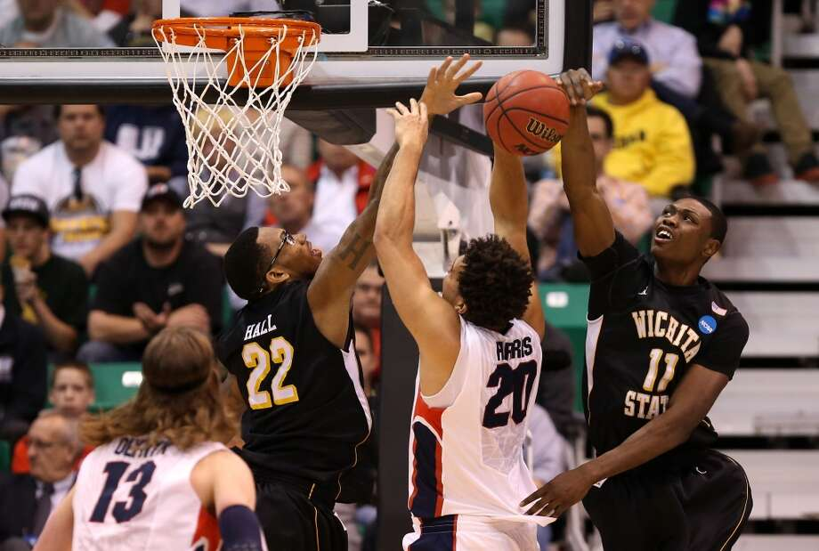 SALT LAKE CITY, UT - MARCH 23:  Elias Harris #20 of the Gonzaga Bulldogs is blocked by Ehimen Orukpe #21 of the Wichita State Shockers in the second half during the third round of the 2013 NCAA Men's Basketball Tournament at EnergySolutions Arena on March 23, 2013 in Salt Lake City, Utah.  (Photo by Streeter Lecka/Getty Images)