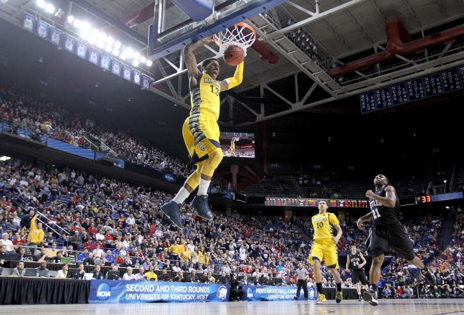 LEXINGTON, KY - MARCH 23:  Vander Blue #13 of the Marquette Golden Eagles dunks the ball during the third round game against the Butler Bulldogs in the 2013 NCAA Men's Basketball Tournament at Rupp Arena on March 23, 2013 in Lexington, Kentucky.  (Photo by Andy Lyons/Getty Images)