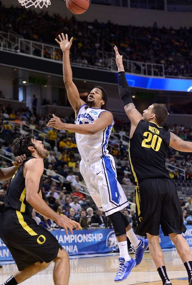 SAN JOSE, CA - MARCH 23:  Dwayne Evans #21 of Saint Louis Billikens shoots over Waverly Austin #20 of the Oregon Ducks in the first half during the third round of the 2013 NCAA Men's Basketball Tournament at HP Pavilion on March 23, 2013 in San Jose, California.  (Photo by Thearon W. Henderson/Getty Images)