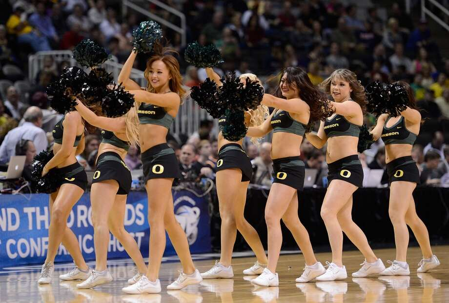SAN JOSE, CA - MARCH 23:   The Oregon Ducks Cheerleaders performs agains Saint Louis Billikens in the first half during the third round of the 2013 NCAA Men's Basketball Tournament at HP Pavilion on March 23, 2013 in San Jose, California.  (Photo by Thearon W. Henderson/Getty Images)
