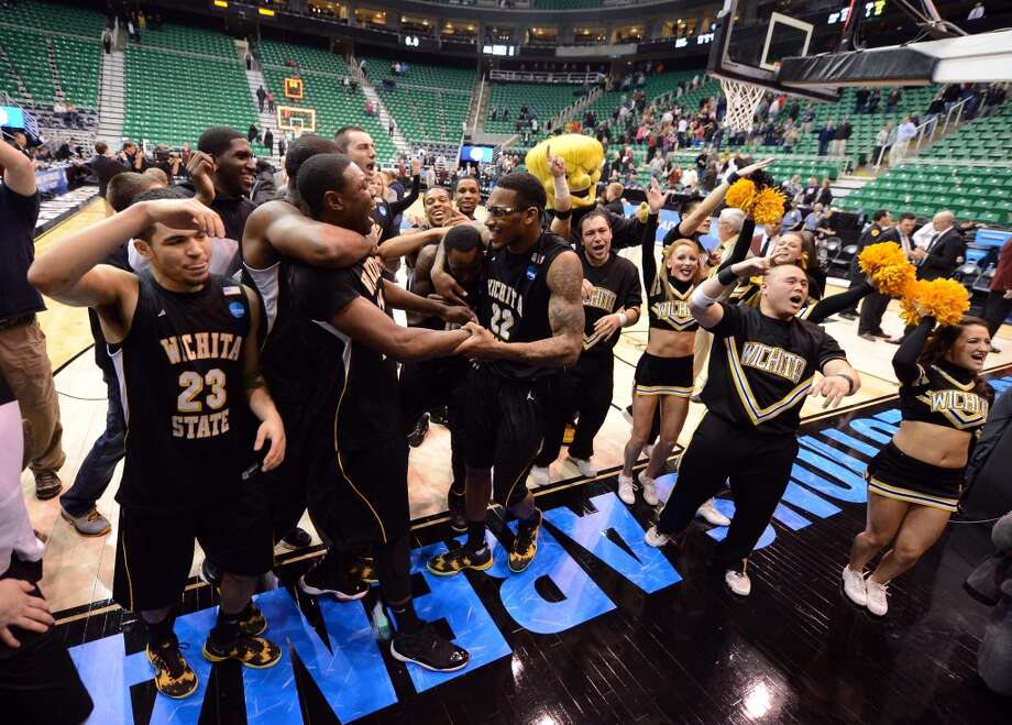 SALT LAKE CITY, UT - MARCH 23:  The Wichita State Shockers celebrate after defeating the Gonzaga Bulldogs 76-70 during the third round of the 2013 NCAA Men's Basketball Tournament at EnergySolutions Arena on March 23, 2013 in Salt Lake City, Utah.  (Photo by Harry How/Getty Images)