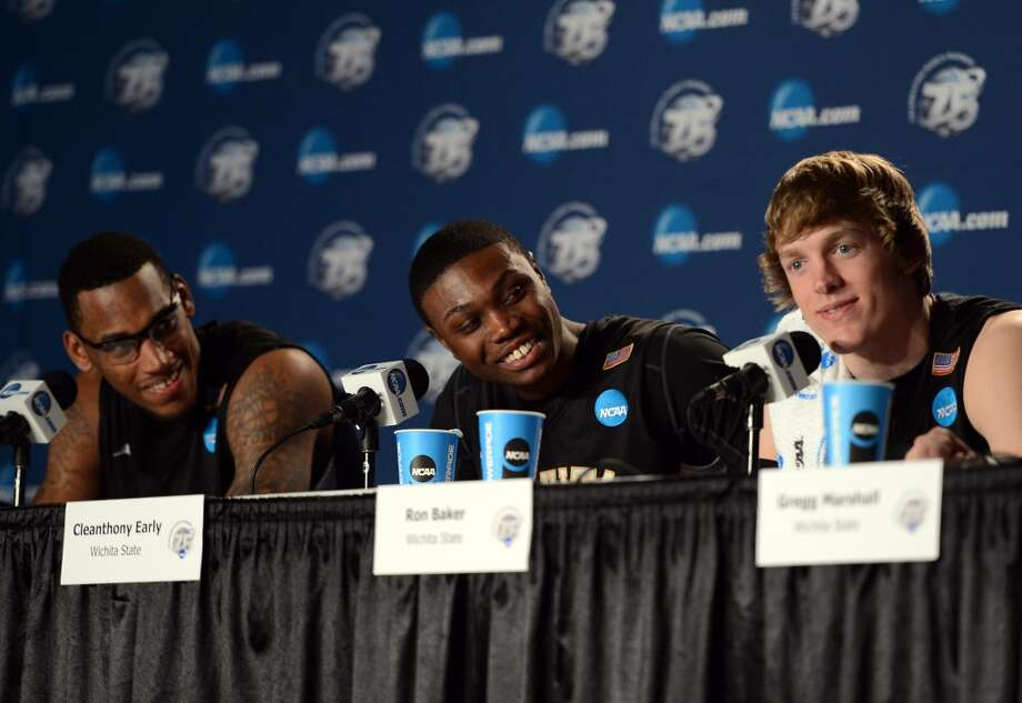 SALT LAKE CITY, UT - MARCH 23:  (R-L) Ron Baker #31, Cleanthony Early #11 and Carl Hall #22 of the Wichita State Shockers smile during a press conference after a 76-70 win over the Gonzaga Bulldogs during the third round of the 2013 NCAA Basketball Tournament at EnergySolutions Arena on March 23, 2013 in Salt Lake City, Utah.  (Photo by Harry How/Getty Images)
