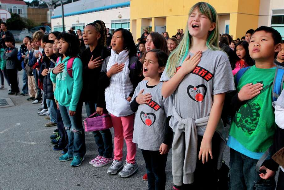 Students in Patricia Juri's 4th-grade class recite the Pledge of Allegiance during a bi-weekly assembly at Argonne Elementary School in San Francisco, Calif. on Friday, March 15, 2013. Photo: Paul Chinn, The Chronicle / ONLINE_YES
