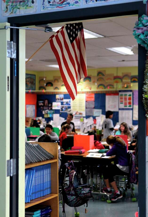 The U.S. flag hangs in David Allyn's 5th-grade classroom at Argonne Elementary School in San Francisco, Calif. on Friday, March 15, 2013. Students at Argonne recite the Pledge of Allegiance during bi-weekly assemblies on the schoolyard. Photo: Paul Chinn, The Chronicle / ONLINE_YES