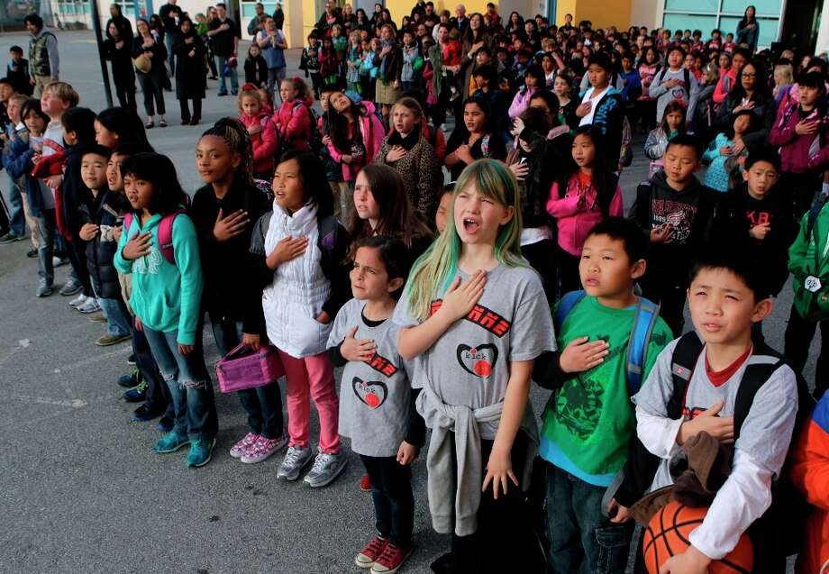 Students recite the Pledge of Allegiance during a bi-weekly assembly before class at Argonne Elementary School in San Francisco, Calif. on Friday, March 15, 2013. Photo: Paul Chinn, The Chronicle / ONLINE_YES