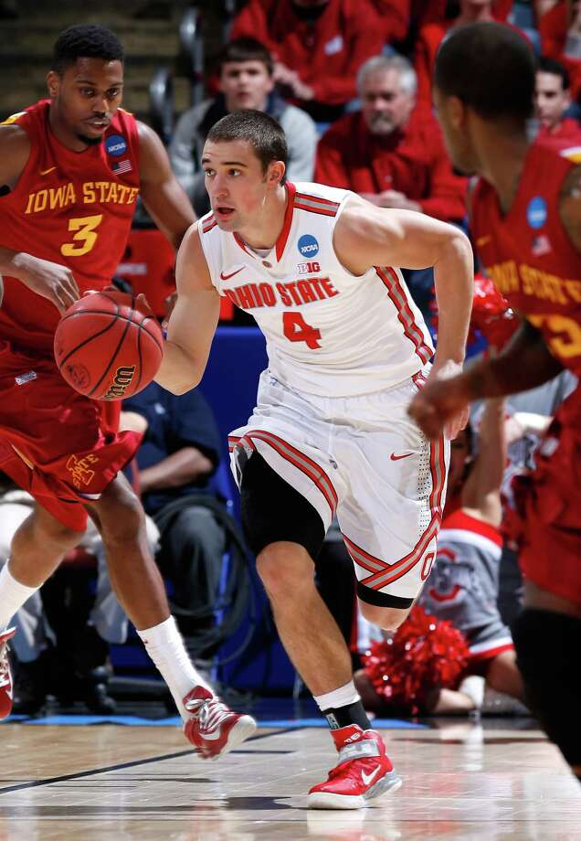 Aaron Craft #4 of the Ohio State Buckeyes handles the ball against the Iowa State Cyclones in the first half. Photo: Joe Robbins, Getty Images / 2013 Getty Images