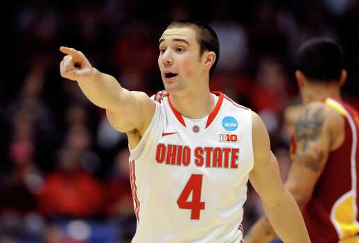 Aaron Craft #4 of the Ohio State Buckeyes gestures after a play against the Iowa State Cyclone. Photo: Jason Miller, Getty Images / 2013 Getty Images