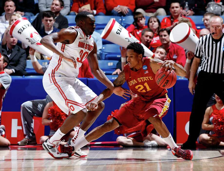 Will Clyburn #21 of the Iowa State Cyclones handles the ball against Evan Ravenel #30 of the Ohio State Buckeyes. Photo: Joe Robbins, Getty Images / 2013 Getty Images
