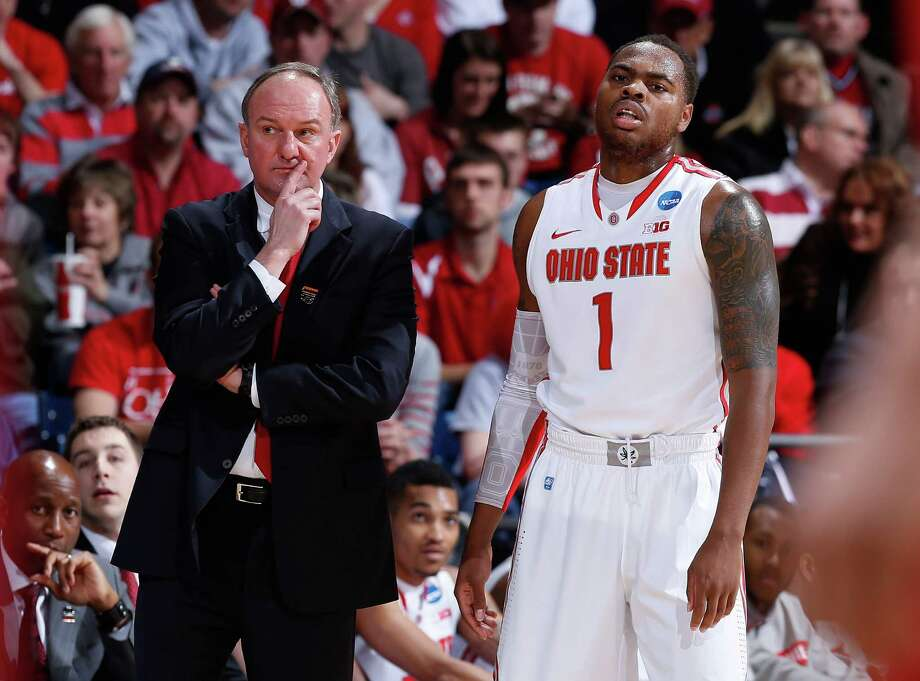 Ohio State coach Thad Matta of the Ohio State Buckeyes and Deshaun Thomas #1 look on from the sideline in the first half. Photo: Joe Robbins, Getty Images / 2013 Getty Images