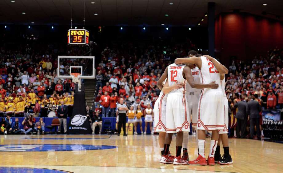 The Ohio State Buckeyes huddle prior to the start of the game against the Iowa State Cyclones during the third round. Photo: Jason Miller, Getty Images / 2013 Getty Images