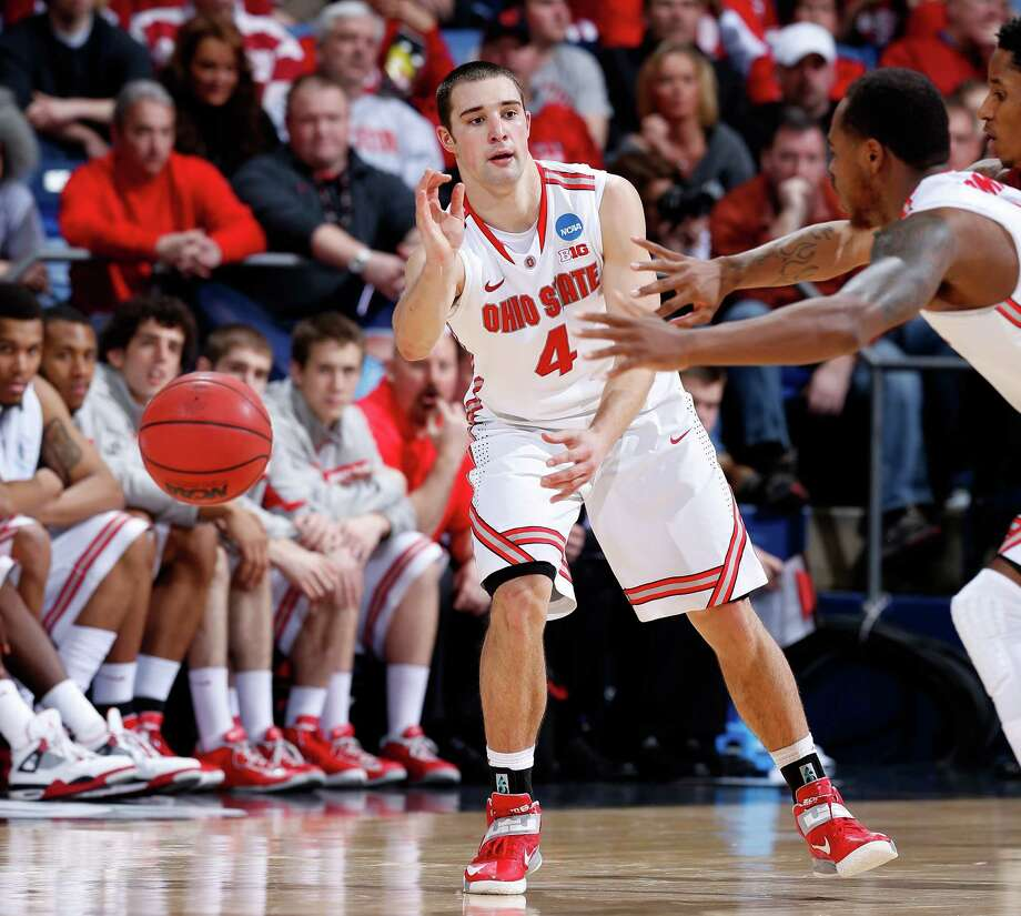 Aaron Craft #4 of the Ohio State Buckeyes passes the ball against the Iowa State Cyclones in the second half. Photo: Joe Robbins, Getty Images / 2013 Getty Images