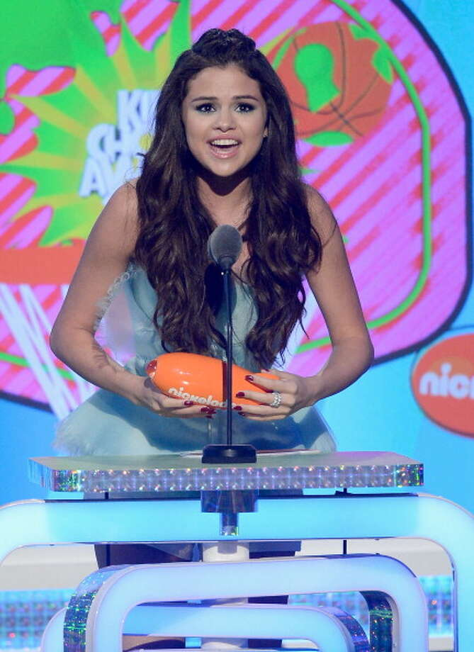 "LOS ANGELES, CA - MARCH 23:  Actress Selena Gomez accepts Favorite Television Actress for ""Wizards of Waverly Place"" onstage during Nickelodeon's 26th Annual Kids' Choice Awards at USC Galen Center on March 23, 2013 in Los Angeles, California.  (Photo by Kevork Djansezian/Getty Images for KCA) Photo: Kevork Djansezian, Getty Images For KCA / Getty Images"