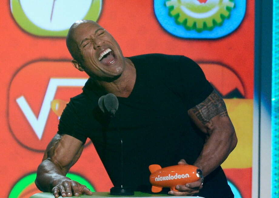 "LOS ANGELES, CA - MARCH 23:  Actor Dwayne Johnson accepts Favorite Male Buttkicker award for ""Journey 2: The Mysterious Island"" onstage during Nickelodeon's 26th Annual Kids' Choice Awards at USC Galen Center on March 23, 2013 in Los Angeles, California.  (Photo by Kevork Djansezian/Getty Images for KCA) Photo: Kevork Djansezian, Getty Images For KCA / Getty Images"