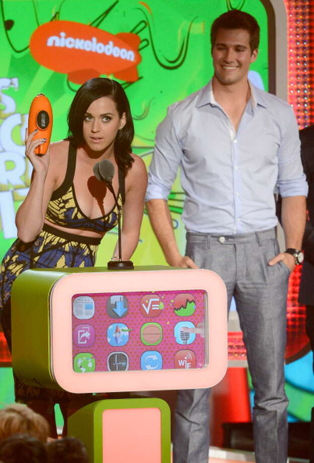 LOS ANGELES, CA - MARCH 23:  Singer Logan Henderson (R) of Big Time Rush looks on as Katy Perry accepts the Favorite Female Singer during Nickelodeon's 26th Annual Kids' Choice Awards at USC Galen Center on March 23, 2013 in Los Angeles, California.  (Photo by Kevork Djansezian/Getty Images for KCA) Photo: Kevork Djansezian, Getty Images For KCA / Getty Images