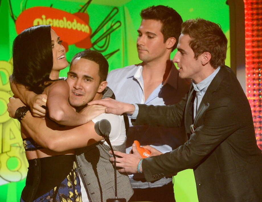 LOS ANGELES, CA - MARCH 23:  Singer Katy Perry, winner of Favorite Female Singer Award, with singers (L-R) Carlos Pena Jr., Logan Henderson and Kendall Schmidt of Big Time Rush speak onstage during Nickelodeon's 26th Annual Kids' Choice Awards at USC Galen Center on March 23, 2013 in Los Angeles, California.  (Photo by Kevork Djansezian/Getty Images for KCA) Photo: Kevork Djansezian, Getty Images For KCA / Getty Images
