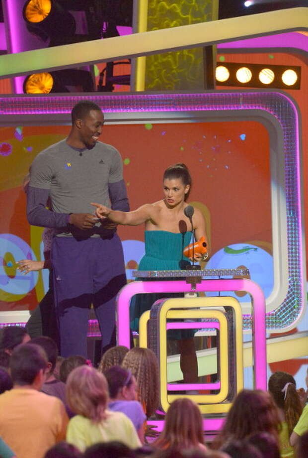 LOS ANGELES, CA - MARCH 23:  NBA player Dwight Howard (L) and NASCAR driver Danica Patrick perform during Nickelodeon's 26th Annual Kids' Choice Awards at USC Galen Center on March 23, 2013 in Los Angeles, California.  (Photo by Lester Cohen/WireImage) Photo: Lester Cohen, WireImage / Getty Images