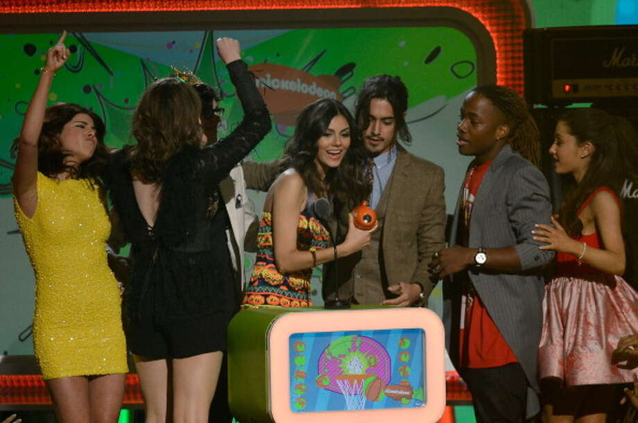 "LOS ANGELES, CA - MARCH 23:  (L-R) Actors Daniella Monet, Elizabeth Gillies, Matt Bennett, Victoria Justice, Avan Jogia, Leon Thomas III and Ariana Grande accept the Favorite TV Show Award for ""Victorious"" onstage during Nickelodeon's 26th Annual Kids' Choice Awards at USC Galen Center on March 23, 2013 in Los Angeles, California.  (Photo by Kevork Djansezian/Getty Images for KCA) Photo: Kevork Djansezian, Getty Images For KCA / Getty Images"