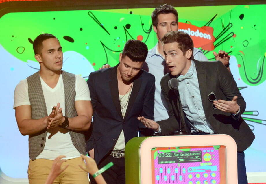 LOS ANGELES, CA - MARCH 23:   (L-R) Singers Carlos Pena Jr., James Maslow, Logan Henderson and Kendall Schmidt of Big Time Rush speak onstage at Nickelodeon's 26th Annual Kids' Choice Awards at USC Galen Center on March 23, 2013 in Los Angeles, California.  (Photo by Jeff Kravitz/FilmMagic) Photo: Jeff Kravitz, FilmMagic / Getty Images