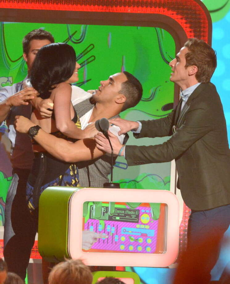 LOS ANGELES, CA - MARCH 23:  (L-R) Singer Katy Perry with singers (L-R) Carlos Pena Jr., Logan Henderson and Kendall Schmidt of Big Time Rush during Nickelodeon's 26th Annual Kids' Choice Awards at USC Galen Center on March 23, 2013 in Los Angeles, California.  (Photo by Lester Cohen/WireImage) Photo: Lester Cohen, WireImage / Getty Images