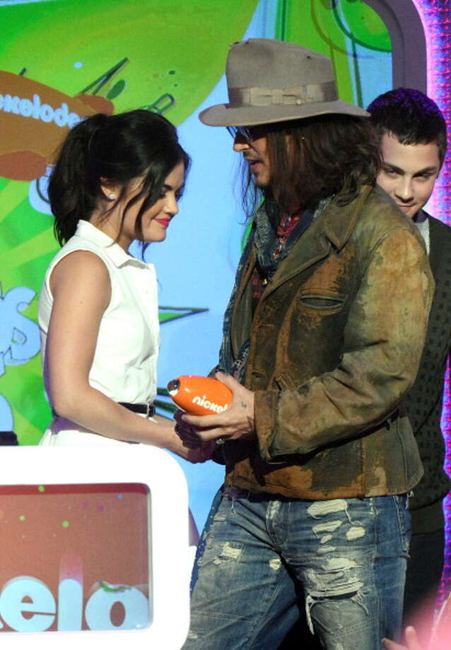 LOS ANGELES, CA - MARCH 23:  Actors  Lucy Hale (L) and Johnny Depp onstage at Nickelodeon's 26th Annual Kids' Choice Awards at USC Galen Center on March 23, 2013 in Los Angeles, California.  (Photo by Jeff Kravitz/FilmMagic) Photo: Jeff Kravitz, FilmMagic / Getty Images