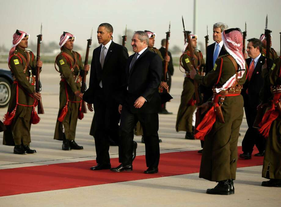 President Barack Obama walks with Jordanian Foreign Minister Nasser Judeh, right, upon his arrival at Queen Alia International Airport in Amman, Jordan, Friday, March 22, 2013. Secretary of State John Kerry and US Ambassador to Jordan Stuart Jones walk behind. Photo: AP