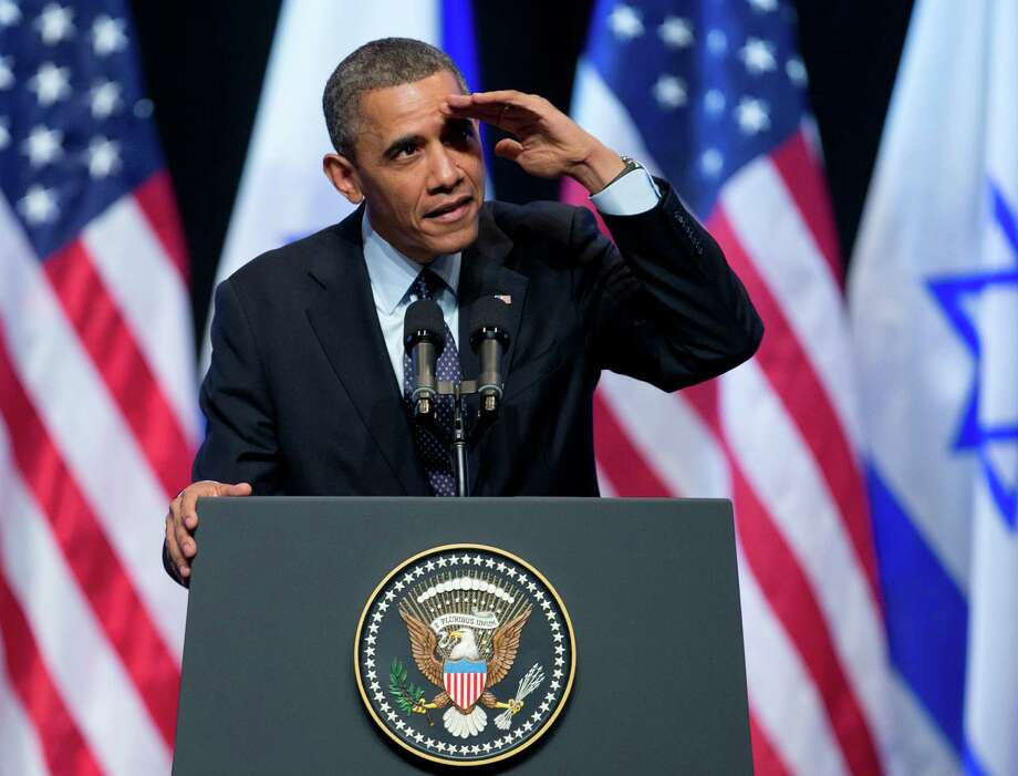 President Barack Obama looks into the crowd for a person yelling at him during his speech at the International Convention Center in Jerusalem, Thursday, March 21, 2013. Photo: AP