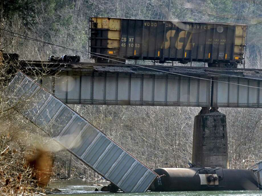 A 64-car, two-locomotive train is derailed in Haysi, Va., Saturday, March 23, 2013. A CSX spokesman said the train was headed from Hamlet, N.C., to Russell, Ky., when 15 cars derailed Saturday morning. No injuries, deaths or evacuations have been reported. Photo: AP
