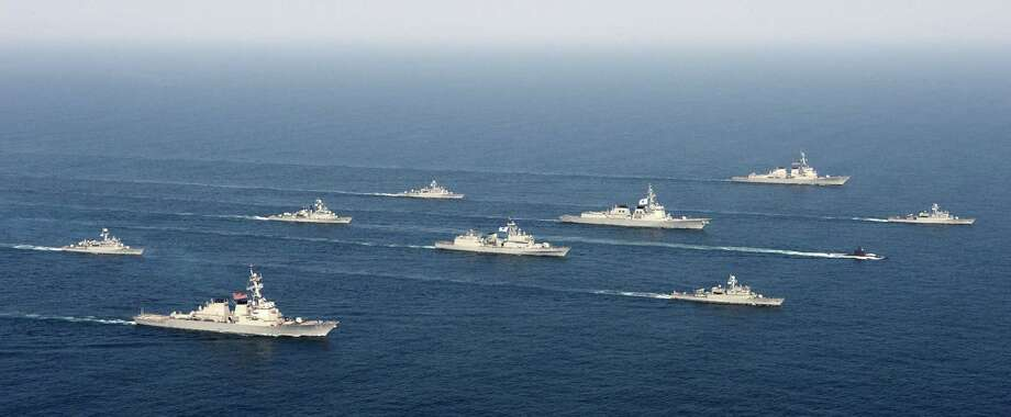"In this photo taken on Tuesday, March 19, 2013, and released by the South Korean Navy via Yonhap on Wednesday, March 20, 2013, South Korea and U.S. warships participate in their joint military drill ""Foal Eagle"" in South Korea's East Sea. North and South Korea staged dueling war games Monday as threatening rhetoric from the rivals rose to the highest level since North Korea rained artillery shells on a South Korean island in 2010. (AP Photo/South Korea Navy via Yonhap) Photo: AP"