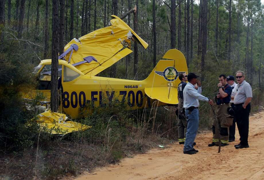 Emergency personnel work the scene of a plane crash on Monday, March 18, 2013, near Panama City, Fla. The pilot escaped with minor injuries. Photo: AP