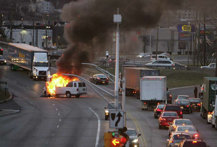 A fully involved van fire on Paterson Plank Rd at Route 3 causes traffic delays in the area in Secaucus, N.J., Monday, March 18, 2013. Photo: AP