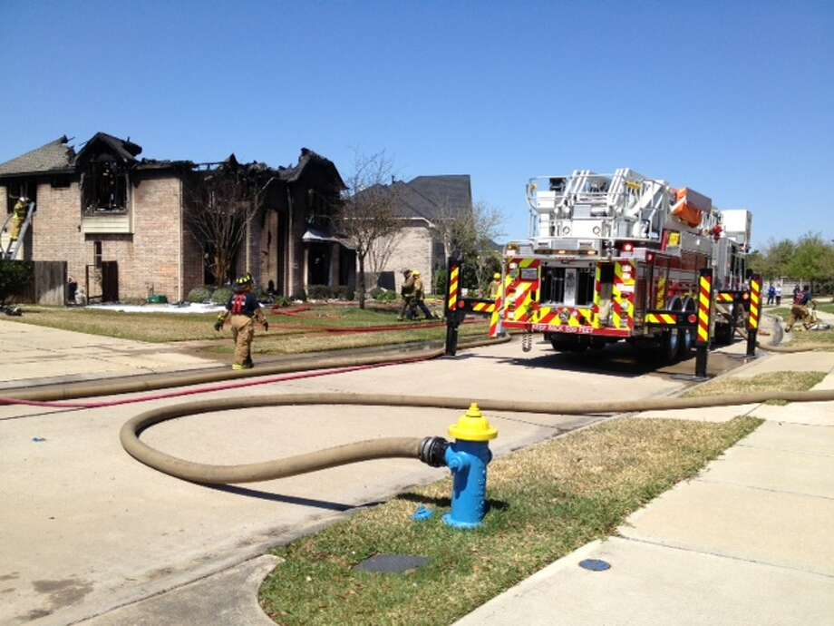 Firefighters respond to a blaze at a structure in Grand Lakes in Katy. Neighbors report that the residents were not home at the time. No other information was immediately available.