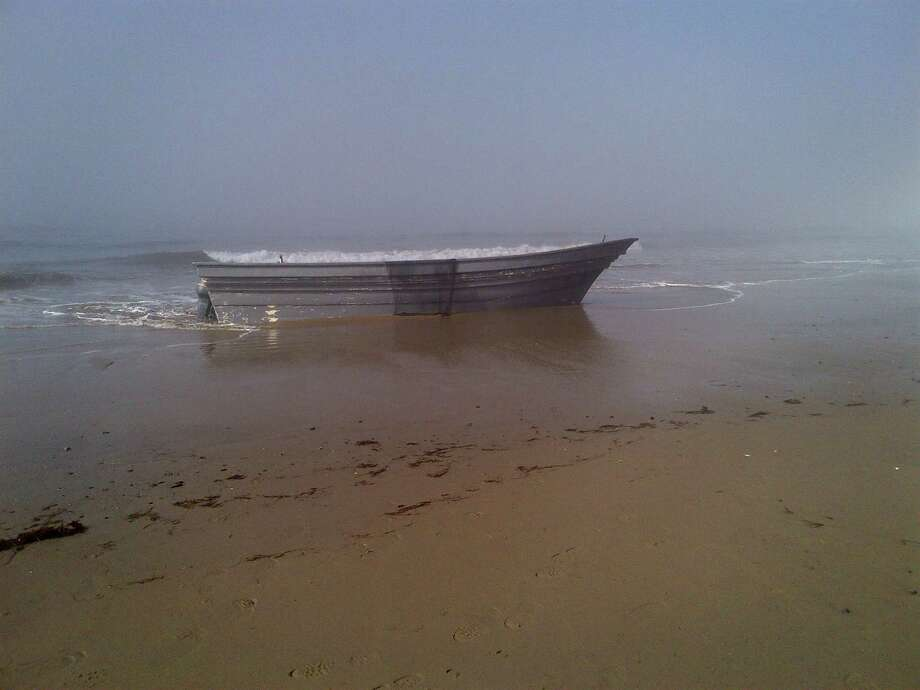 In this photo provided by the Santa Barbara County Sheriff's Office, a panga boat is washed up at Arroyo Camada beach in Santa Barbara County. Authorities found about $4 million worth of marijuana Sunday at Arroyo Quemado Beach next to the panga boat Sunday March 17,2013. There was an estimated 2,000 pounds of pot wrapped in plastic bags on the beach. The boat was apparently abandoned and had at least 20 fuel containers on board. Panga boats are often used for smuggling people or drugs into the United States from Mexico. Photo: AP