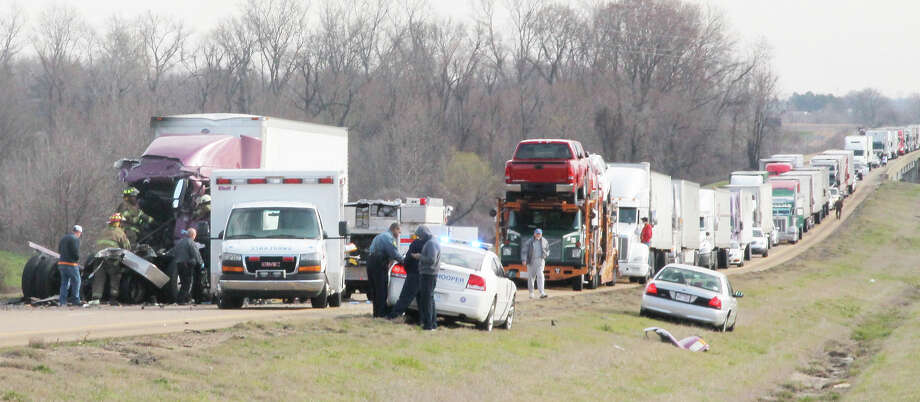 Emergency crews with the Forrest City Fire Department and St. Francis County EMS work to extract the driver of one of two tractor trailers involved in an accident on Interstate 40 Thursday, March 21, 2013 in Forrest City, Ark. The accident caused traffic congestion on the interstate and through Forrest City for several hours. At least one person was airlifted from the scene to Memphis for treatment of injuries. Photo: AP