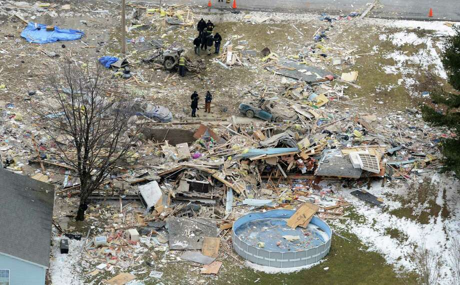 In this aerial photo, Pennsylvania State Police and ATF officials continue to investigate the bombing at the home of William M. Shaner near Patton, Pa. Wednesday, March 20, 2013. Bradley Kollar, an acquaintance of Shaner who blew up himself with a device in his truck that leveled his home, tried to commit suicide last summer with a 1,600-pound fuel bomb similar to one used to blow up the Oklahoma City federal building in 1995, a prosecutor said Wednesday. State police Trooper John Matchik said that investigators don't yet know what chemicals were used in Tuesday's explosion and that he couldn't explain why county 911 dispatchers initially said the explosion was sparked by a meth lab. Photo: AP