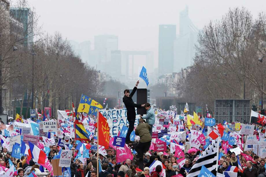 "Anti gay marriage and gay adoption protestors demonstrate, in Paris, Sunday, March. 24, 2013. Thousands of French conservatives, families and activists have converged on the capital to try to stop the country from allowing same-sex couples to marry and adopt children. The lower house of France's parliament approved the ""marriage for everyone"" bill last month with a large majority, and it's facing a vote in the Senate next month. Both houses are dominated by French President Francois Hollande's Socialist Party and its allies. Photo: AP"